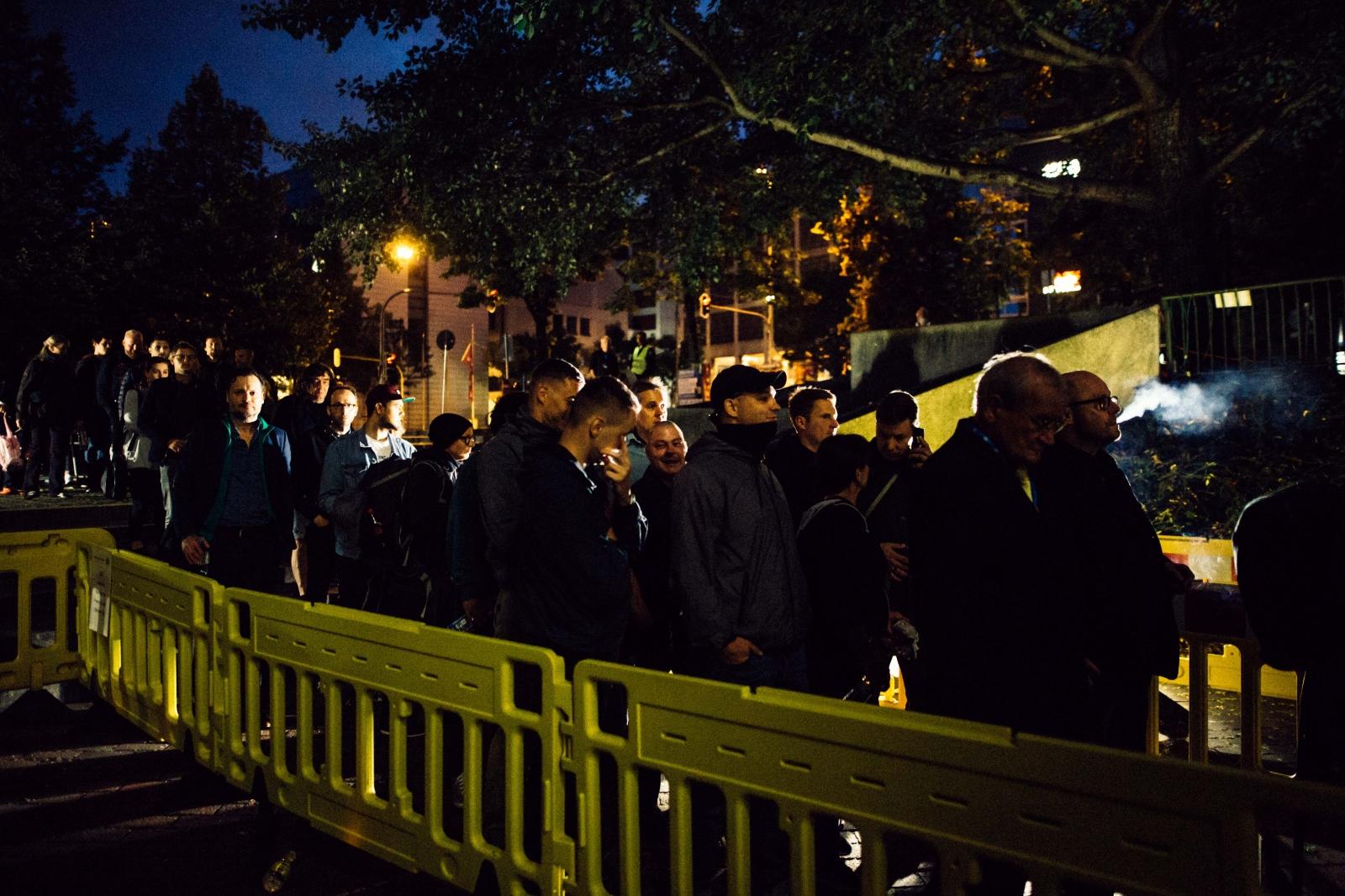 Neo-nazis standing in line.