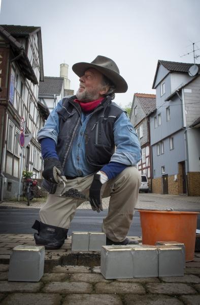German Conceptual Artist Gunter Demnig starts work at Untergasse in Felsberg, Hessia, Germany.