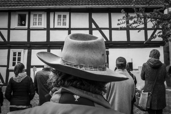 German Artist Gunter Demnig wearing his trade mark hat at The Stolpersteine ceremony in Felsberg. Students from the local school of Drei-Burger Schule along with local Historical Author Dr Dieter Vaupel start the proceedings in memory of the the Dannenberg-Deutsch-Family outside their last residence before being transported to the Concentration Camps.