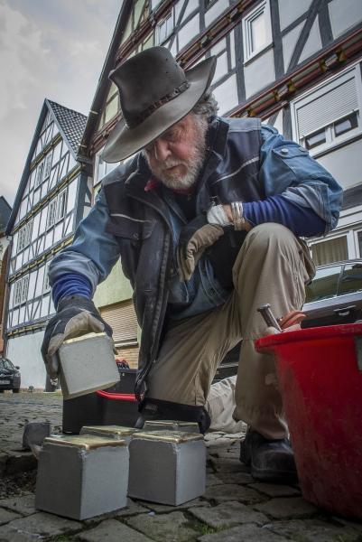 German Conceptual Artist Gunter Demnig placing the Stolpersteine in Treysa, in the German District of Schwalmstadt.