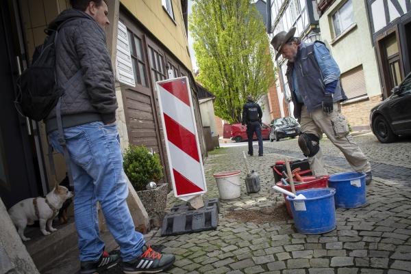 German Conceptiual Artist Gunter Demnig placing the Stolpersteine in Treysa, in the German District of Schwalmstadt.