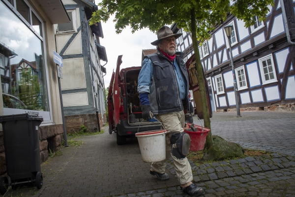 German Conceptual Artist Gunter Demnig makes his way to the place where he'll start laying the Stolpersteine in Treysa, in the German District of Schwalmstadt.