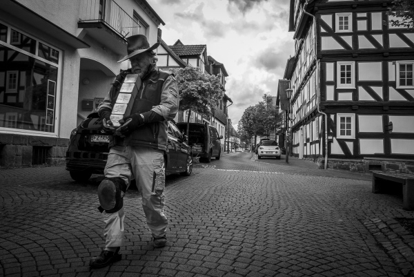 """German Conceptual Artist Gunter Demnig makes his way to the place where he'll start laying the Stolpersteine in Treysa, in the German District of Schwalmstadt. Demnig often cites the Talmud (the central text of Rabbinic Judaism and the primary source of Jewish religious law) stating clearly that """"A person is only forgotten when his or her name is forgotten"""""""