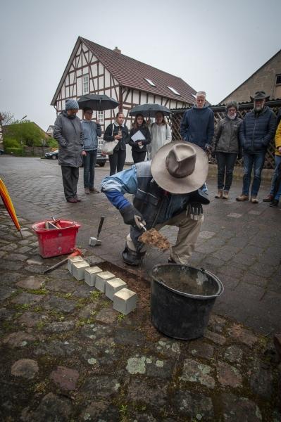German Conceptual Artist Gunter Demnig at work in Ahlheim, Hessia, Germany.