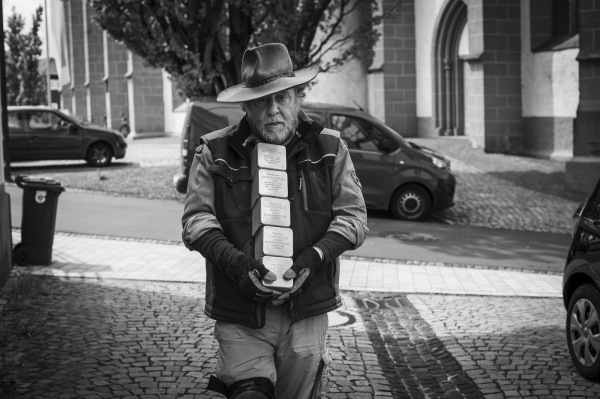 German Conceptual Artist Gunter Demnig makes his way to the place where he'll start laying the Stolpersteine in Treysa, in the German District of Schwalmstadt, Germany.