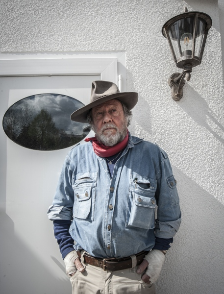 """German 'Conceptual Artist' Gunter Demnig. Demnig who conceived and initiated the 'Stolperstein' art project; 'An art project that commemorates the victims of National Socialism. Keeping alive the memory of all Jews, Roma and Sinti, Homosexuals, Dissidents ,Jehovah's Witnesses and victims of Euthanasia who were deported and exterminated.' Stolpersteine; literally """"stumbling stone"""", is a sett-size, 10 by 10 centimetres (3.9 in × 3.9 in) concrete cube bearing a brass plate inscribed with the name and life dates of victims of Nazi extermination or persecution. The Stolpersteine project, started by the Gunter Demnig in 1992, aims to commemorate individuals at exactly the last place of residency—or, sometimes, work—which was freely chosen by the person before he or she fell victim to Nazi terror, euthanasia, eugenics, was deported to a concentration or extermination camp, or escaped persecution by emigration or suicide. To date some 73.000 Stolpersteine have been laid making the Stolpersteine project the world's largest decentralized memorial. Demnig often cites the Talmud (the central text of Rabbinic Judaism and the primary source of Jewish religious law) stating clearly that """"A person is only forgotten when his or her name is forgotten"""""""