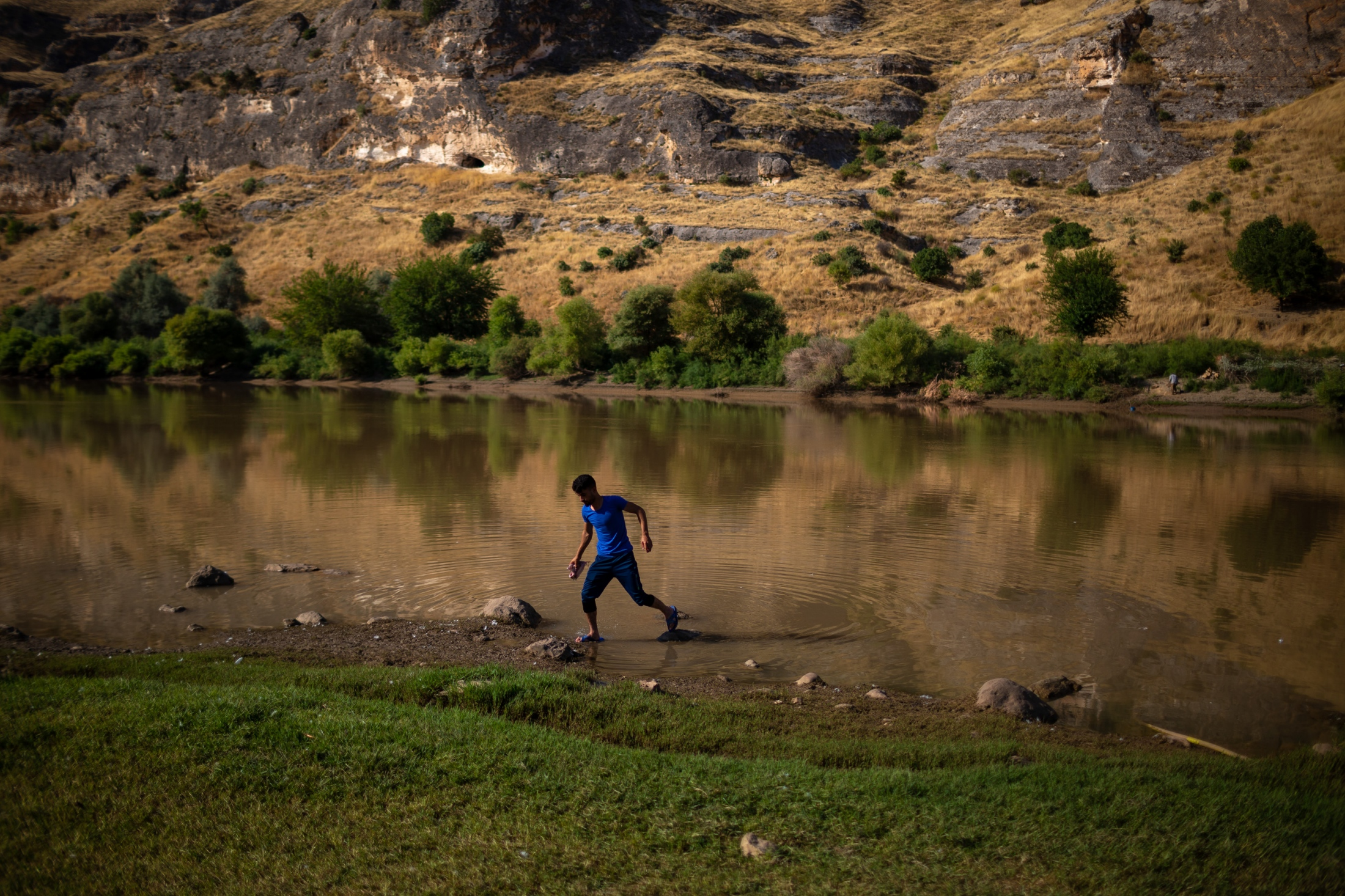 A fisherman returns from fishing for his lunch in the Tigris River. The residents of the villages in the flood zones, including Hasankeyf, have lived independently for generations: living off of the land, their cattle, their agriculture and various commercial enterprises.