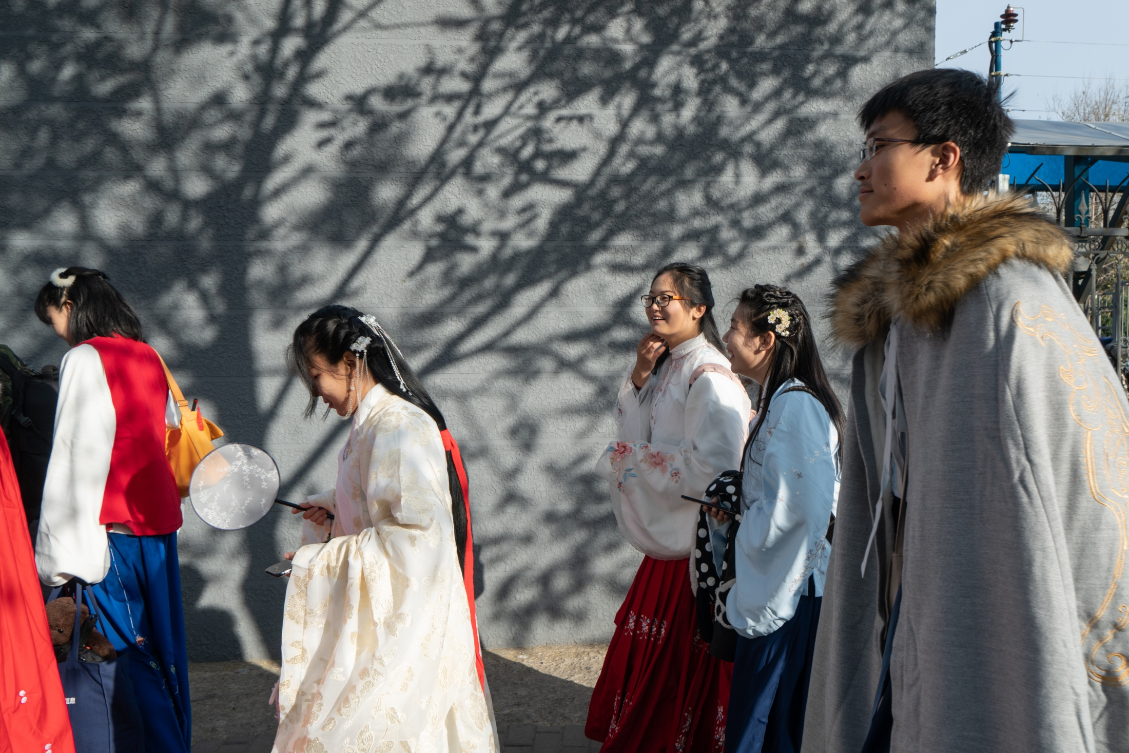 A group of Hanfu devotees walk in the streets of Beijing wearing Hanfu to promote the traditional clothes, November 2018.