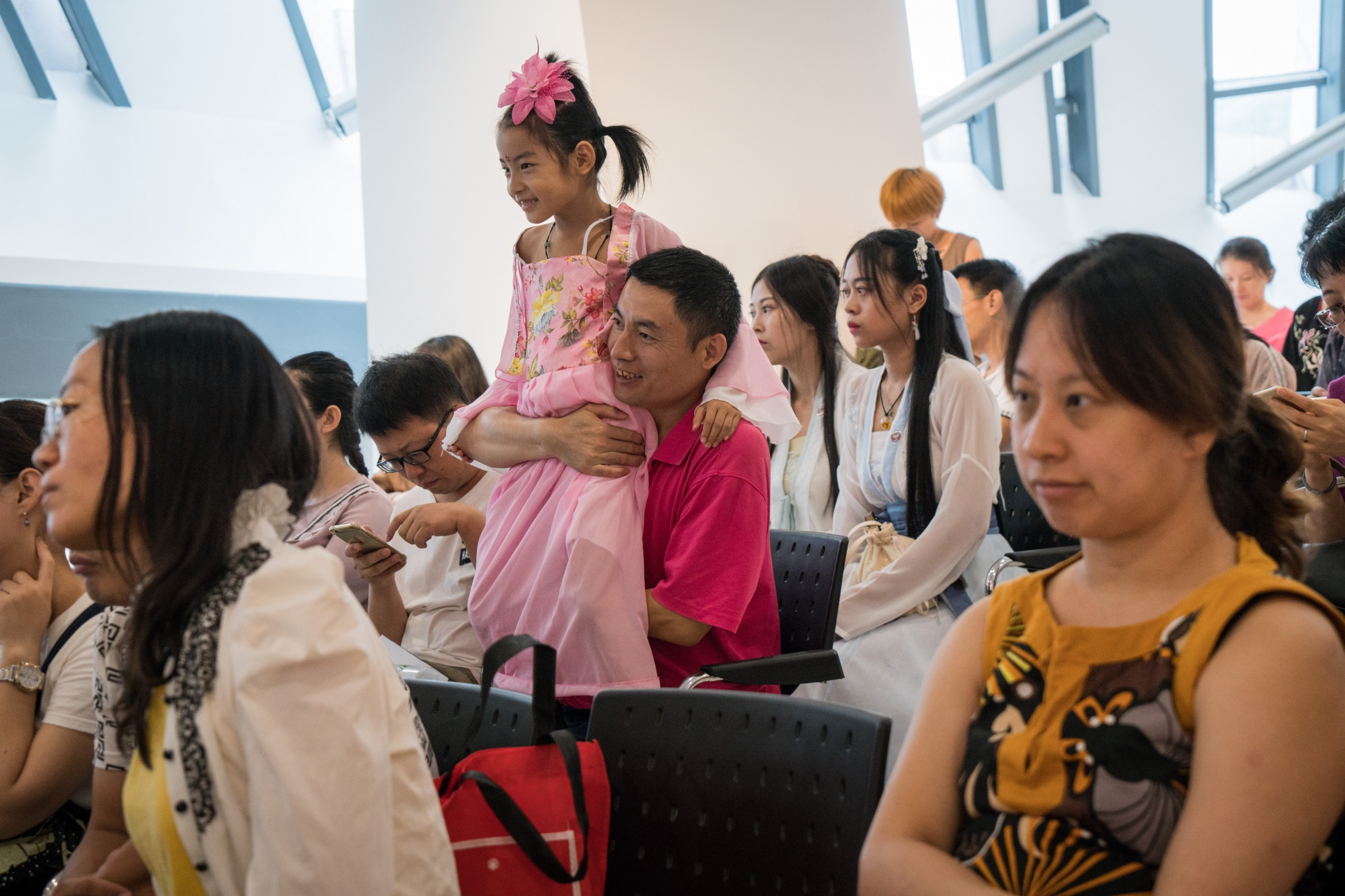 A girl, dressed in Hanfu, attends an event promoting Hanfu and traditional Chinese culture with her father in Beijing, August 2018.