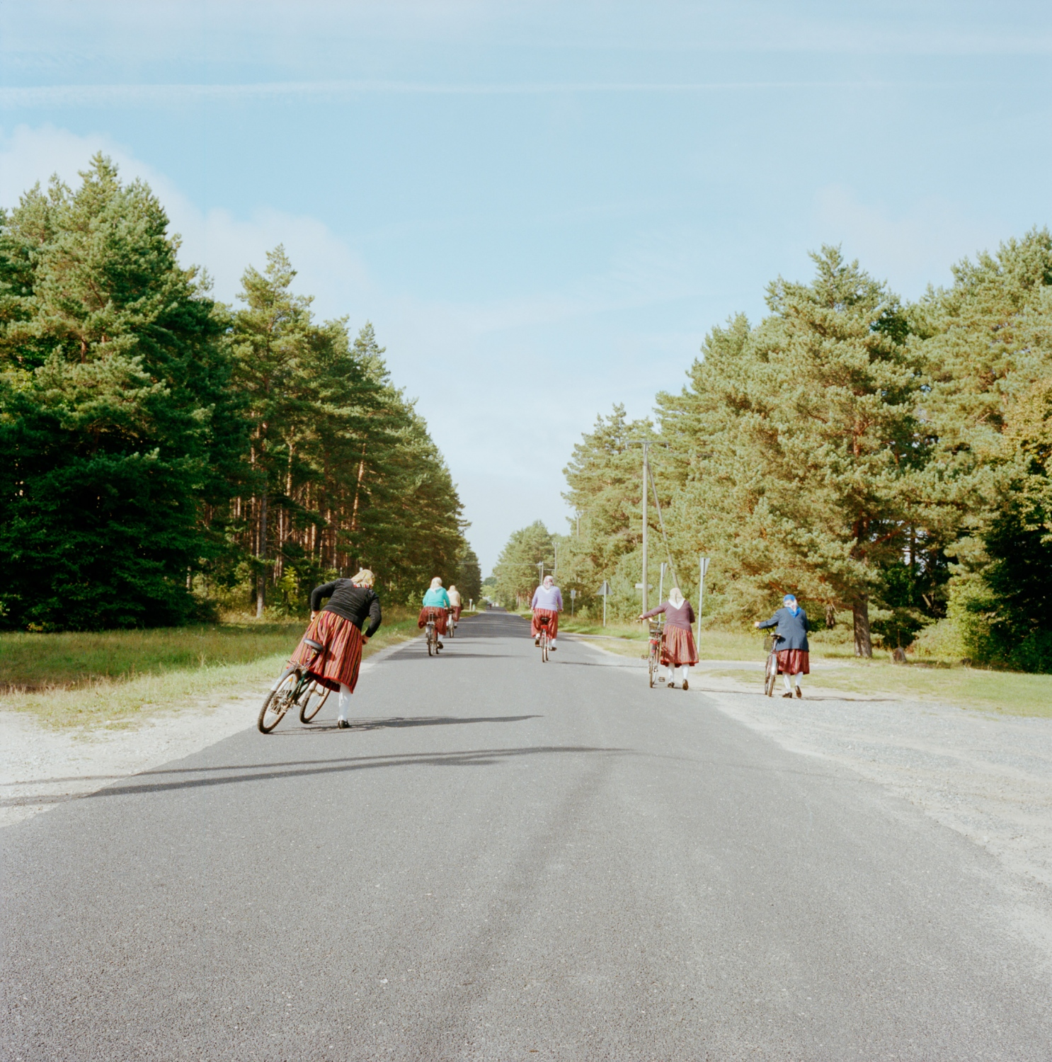 Although cars and motorcycles do circulate across the island's 16 km2, cycling is a much more common method of getting around. Here, women head home after the monthly orthodox mass.