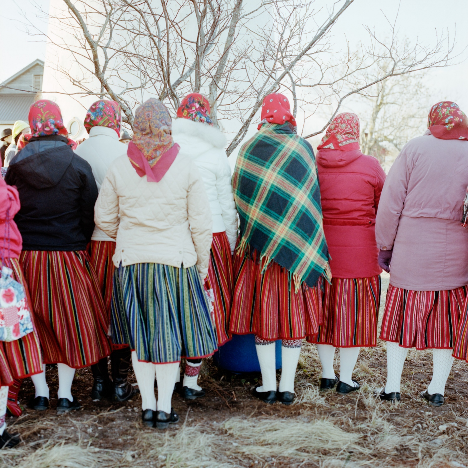 The colour of this skirt is imbued with meaning. During mourning, the skirt should be black, and progressively, with time, blue will be reintroduced before the skirt eventually turns bright red again. As skirts always retain some mark from the mourning period, younger women tend to wear much brighter skirts than older women.