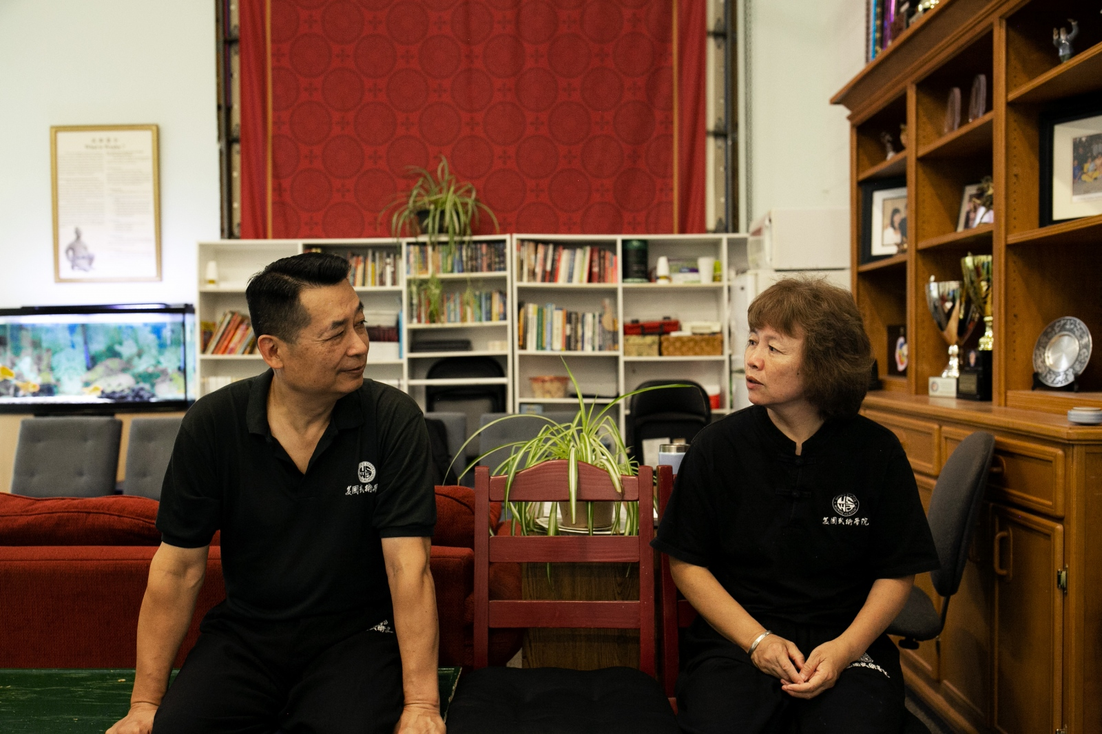 Pei and Zhang chat during a class break. The couple met and married in the 1980s.