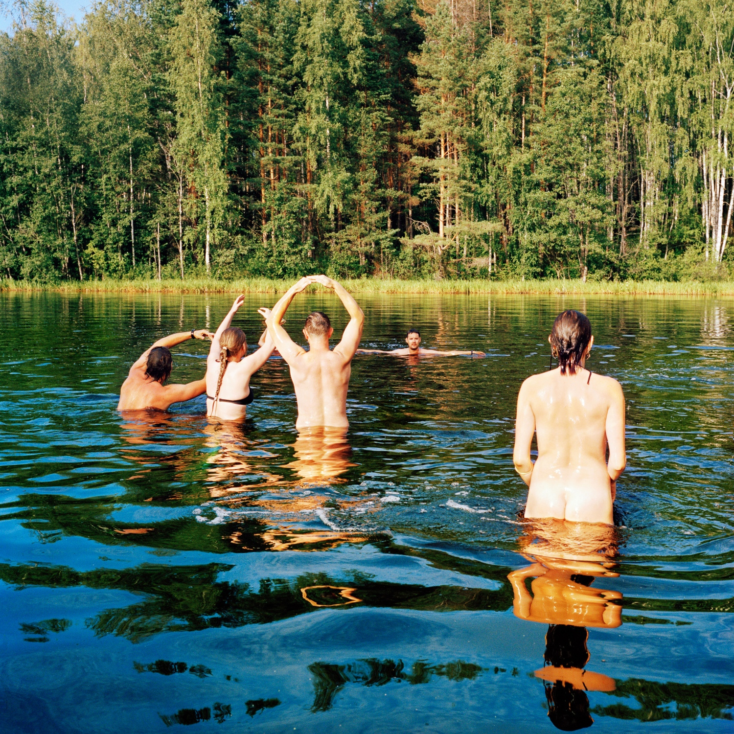 Near Saatse, Estonia, the Russian-Estonian border runs through the middle of this lake, where bathers play a ball game and frolic.