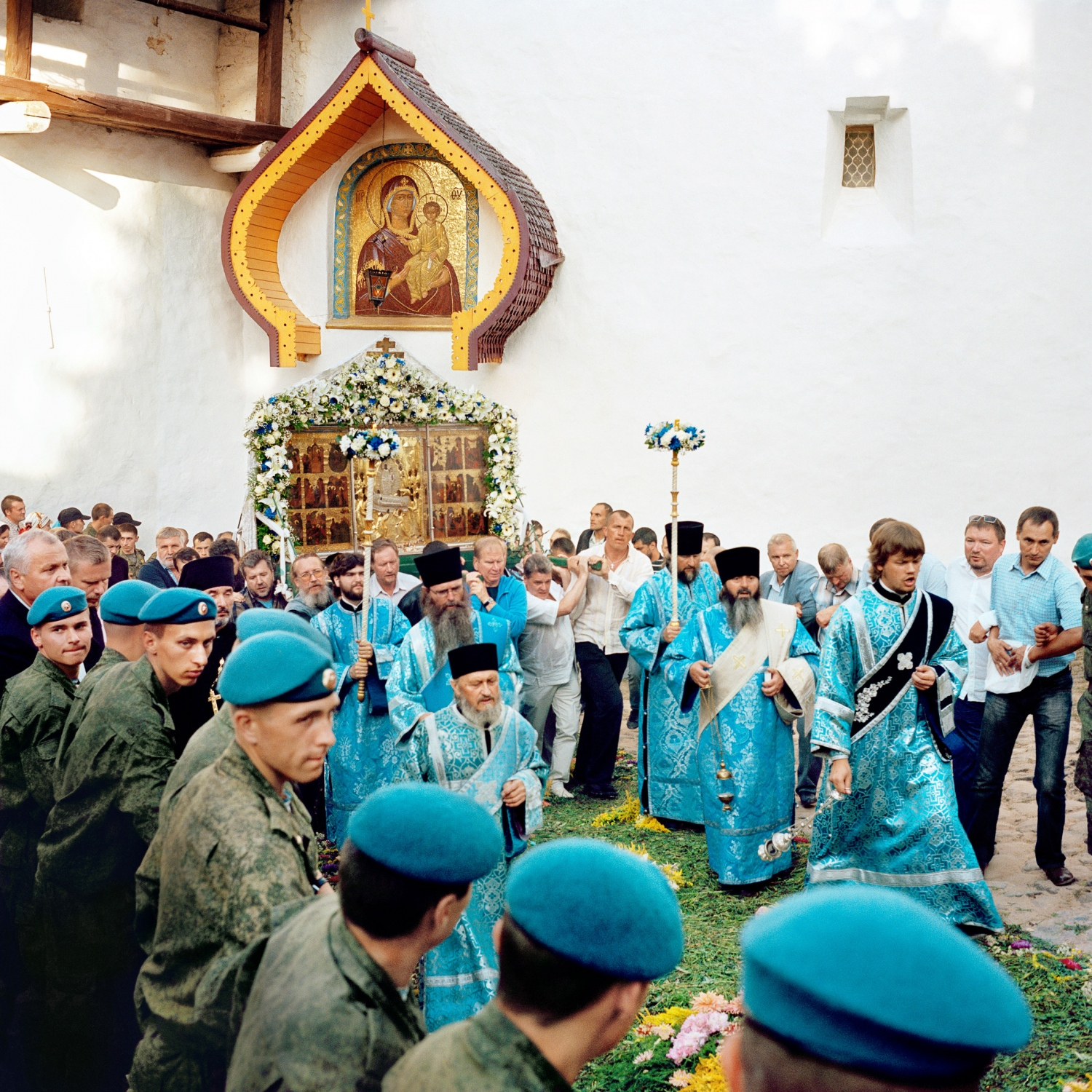 An icon is carried around the Pechory Monastery on the day of the Dormition of the Mother of God. Both civilians and members of the Russian Army gather to help protect the icon as it's viewed by the faithful—a group that includes Setos from both sides of the border as well as Russian Orthodox believers.