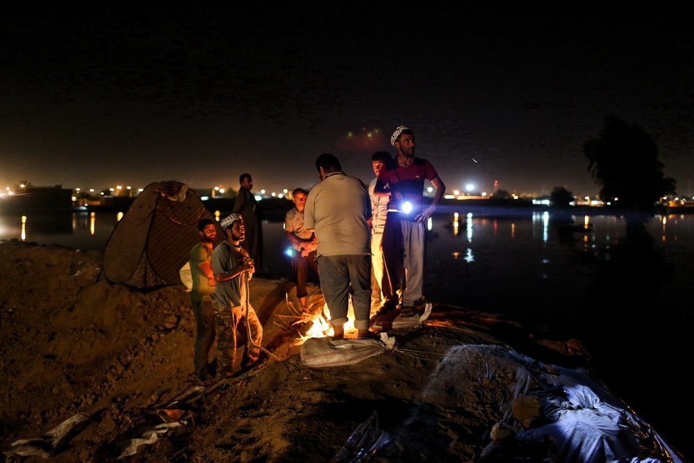 From the early days of the floods, people began building levee to prevent water from entering their homes. Men watched over the levees every night , if the levees are damaged , they can prevent flood into the city . hamidied /Ahvaz