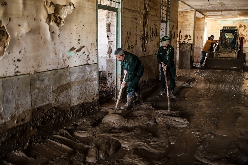 The IRGC forces are cleaning the schools that destroyed in the recent flood of iran . lorestan