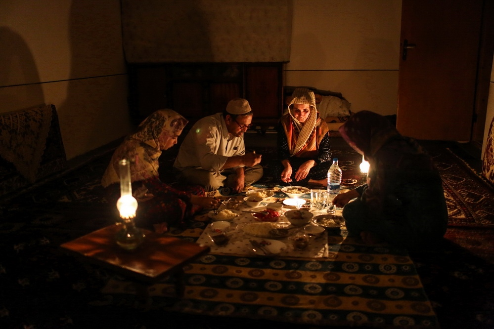 Since the begun of flood in the northern cities of Iran, electricity has been cut off in many areas for three weeks, both due to damage to urban infrastructure and  both public safety. A family is having dinner in the dark of night. Gulistan