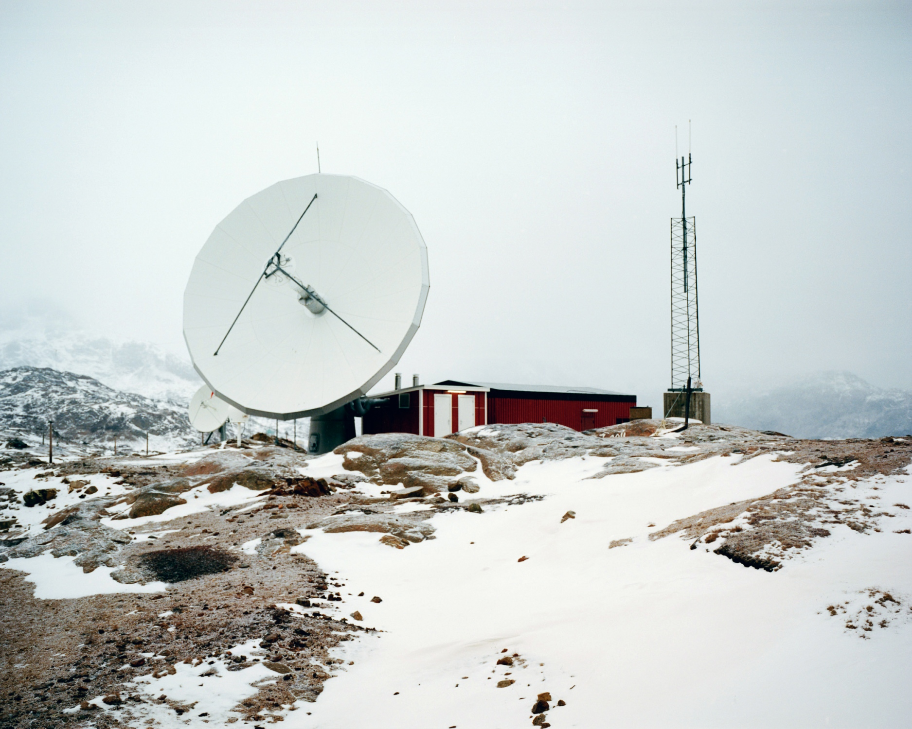 Telecommunication centre in Tasiilaq connecting the village to the phone, the internet and television network. Tasiilaq is one of the most remote village in Greenland. Located the east coast of Greenland, populated by 2017 in- habitants (2013). Tasiilaq is the poorest village in Greenland and has a really high suicide rate among youngsters.