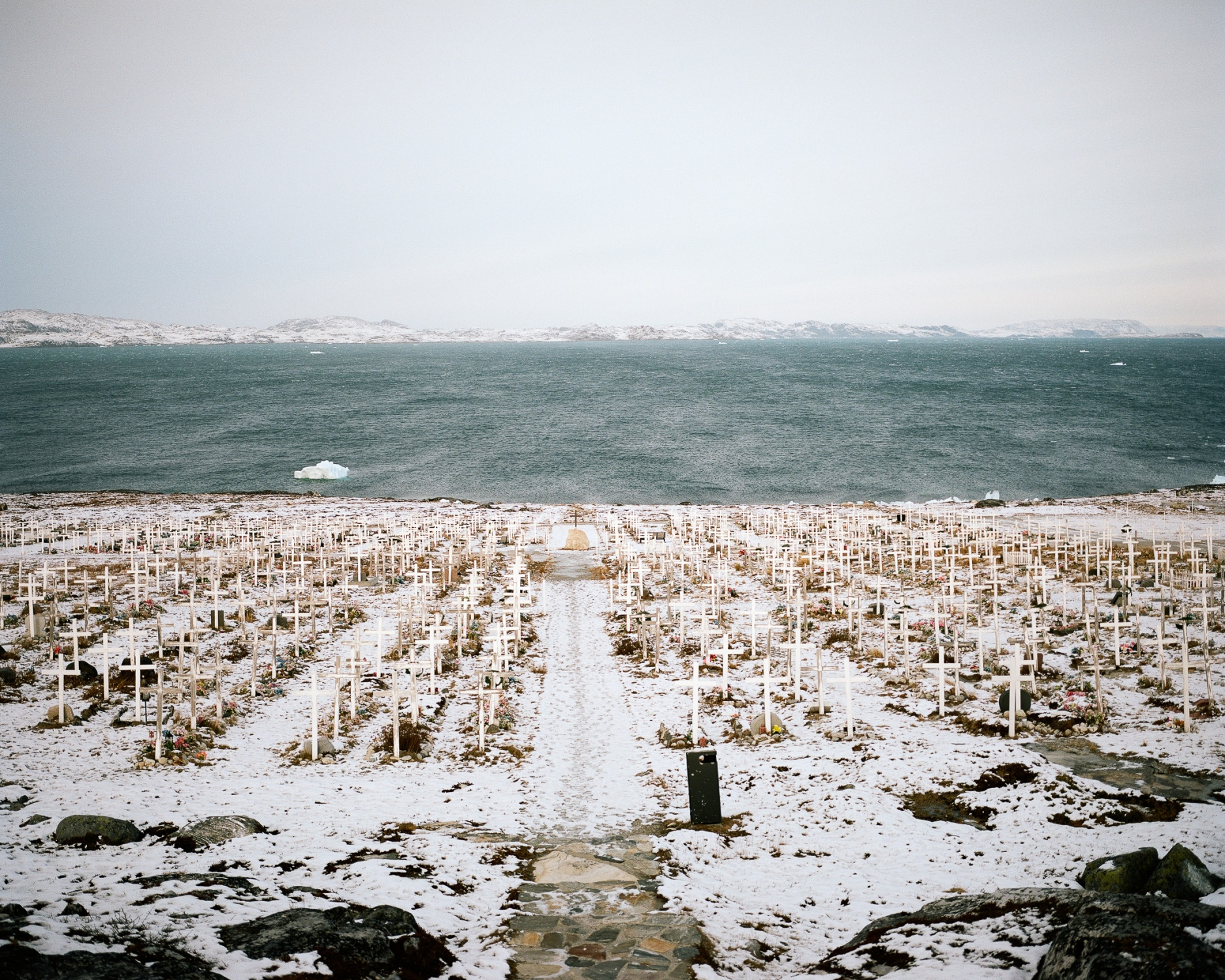 Nuuk cemetery. Nuuk, the capital city and most populated city of Greenland (16 454 habitants) is the administrative centre of the island with all institutions and administrative buildings.