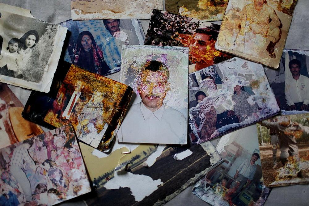 Memorial photos of a family who were Destroyed in the great flood of Aq qala city .