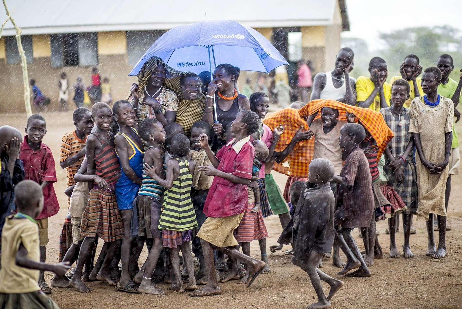 Pupils dodge a sudden downpour in Moroto, Eastern Uganda 2016.