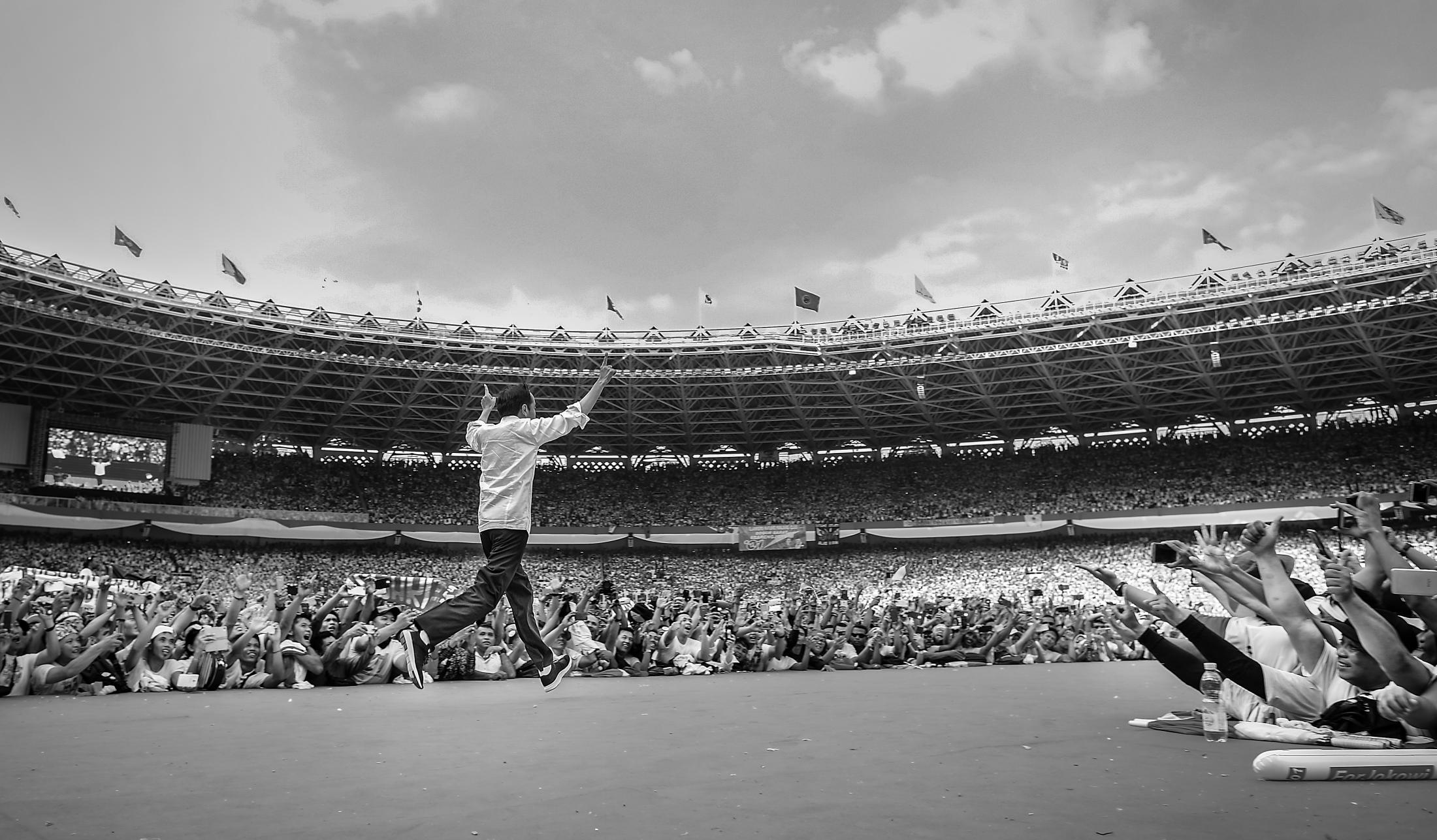 Indonesia's incumbent presidential candidate Joko Widodo enters the stage with a campaign hand sign indicating a number one, his ballot number, at a campaign rally at Gelora Bung Karno stadium in Jakarta, Indonesia, April 13, 2019. Widodo, 57, know as Jokowi, was running on his own record for a second term, he beat former general Prabowo Subianto for his 2nd term.