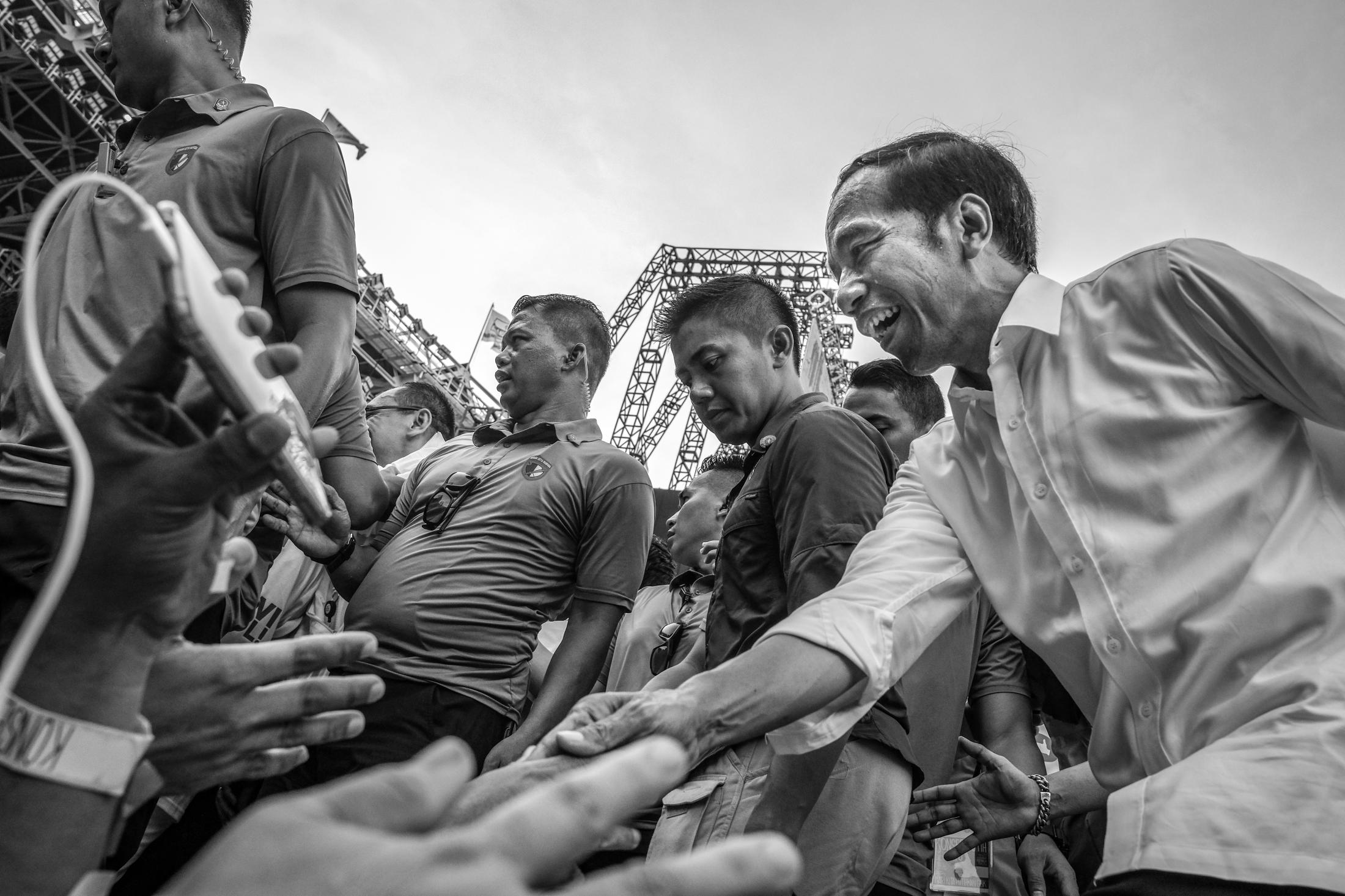Indonesia's incumbent presidential candidate Joko Widodo greets his supporters during a campaign rally at Gelora Bung Karno stadium in Jakarta, Indonesia, April 13, 2019. Widodo, 57, know as Jokowi, is running on his own record for a second term beat former general Prabowo Subianto for his second term.