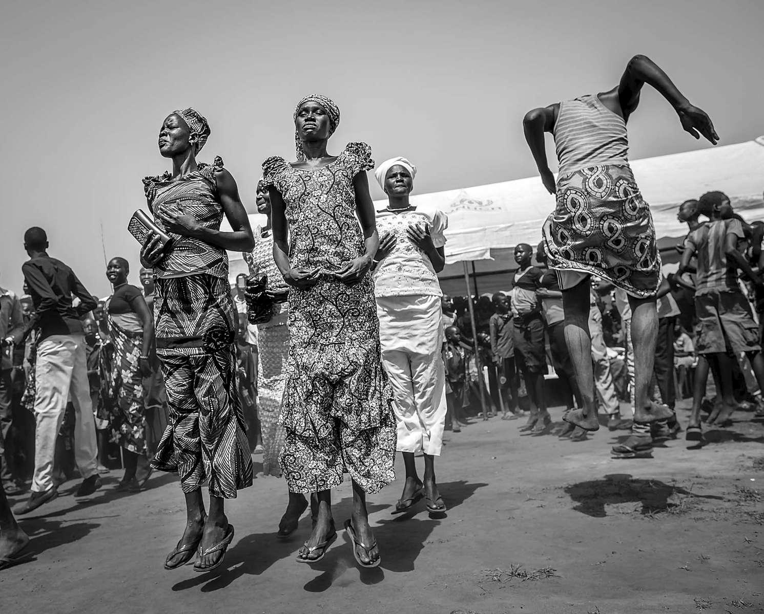 Refugees engage in a tribal dance at Nyumanzi Transit Center in Adjumani district of Uganda on August 29, 2016.