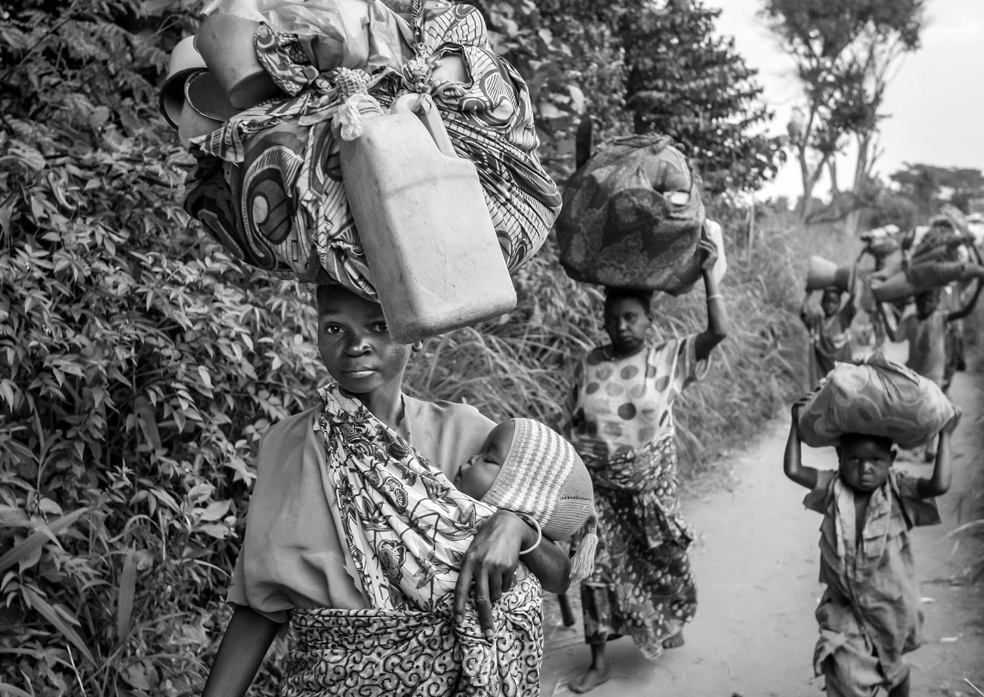 With all they can carry, Congolese IDPs make a long journey to find a safe haven near the village of Gety in mineral-rich Ituri region.