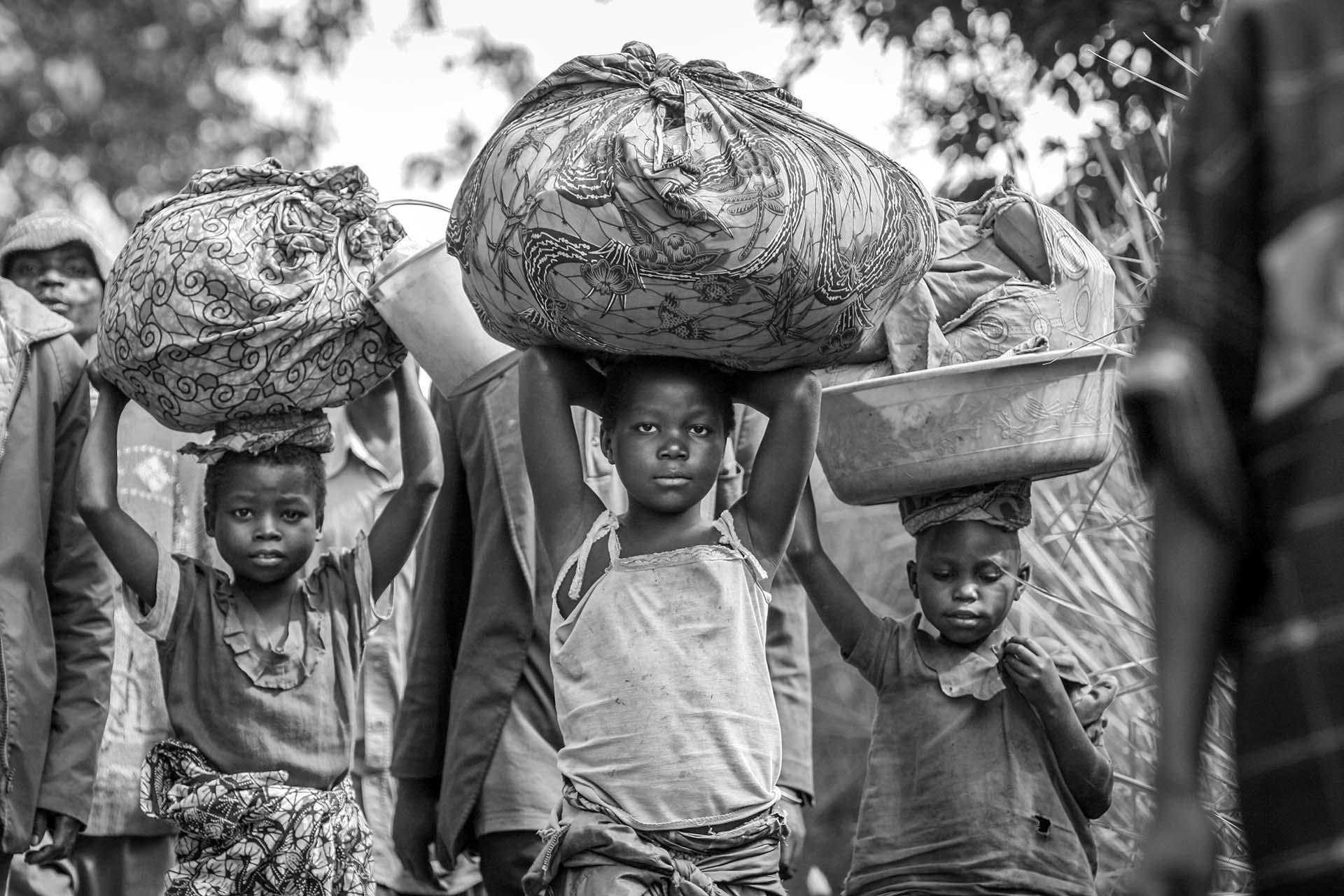 With all their worldly goods, Congolese, women and children, make a long journey to find a safe haven near the village of Gety in Ituri region.