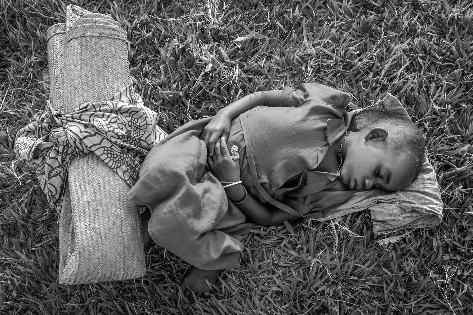 A girl rests after a long journey at a Catholic church in the village of Gety, 60 km southwest of Bunia, regional capital of Ituri region in eastern DR Congo. Fighting between government forces and militia groups, meant tens of thousands were displaced in the area.