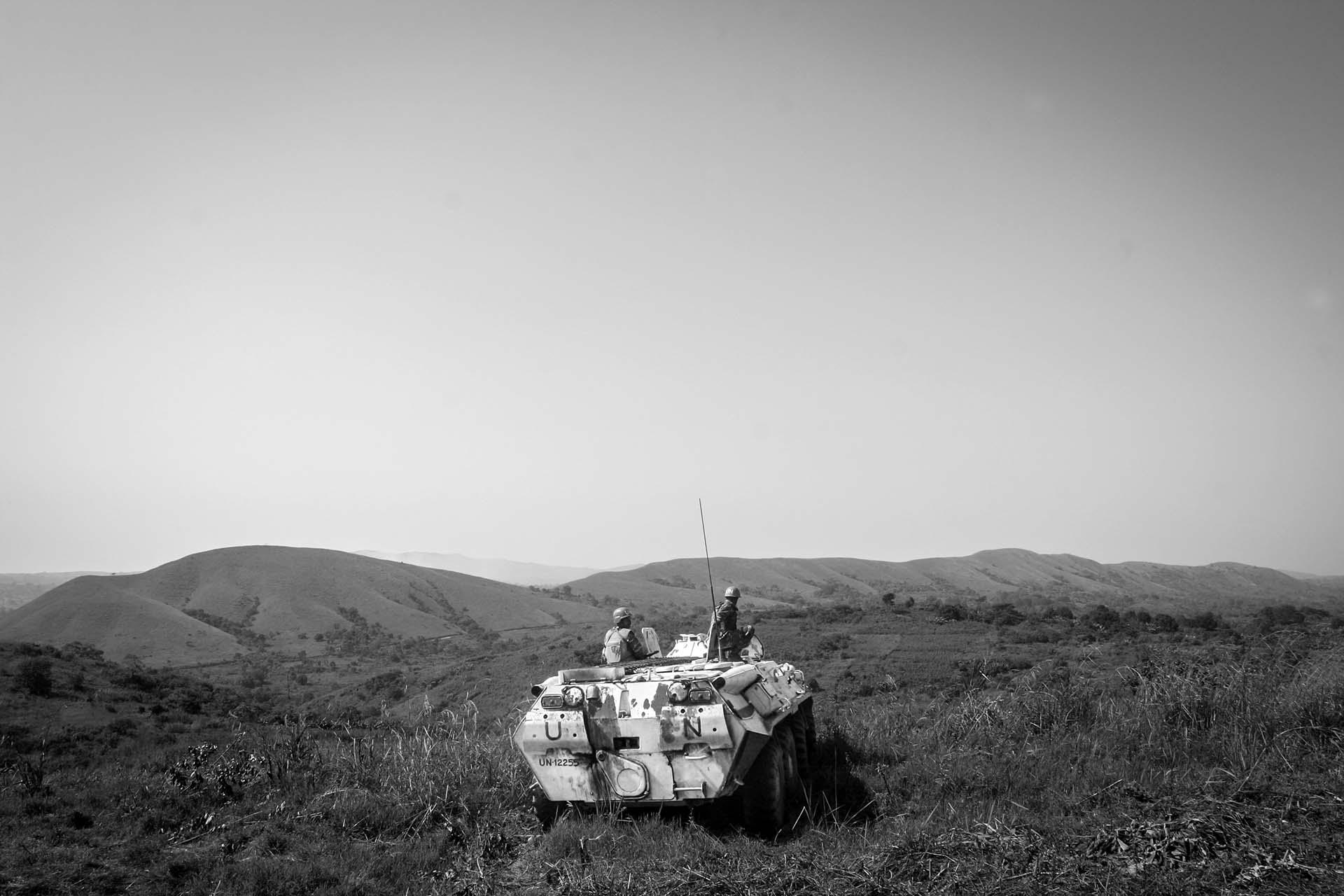 Bangladeshi  UN peacekeepers ride an armored personnel carrier to the hilltop overlooking the village of Bavi, the scene of fighting between UN supported government troops and local insurgents.