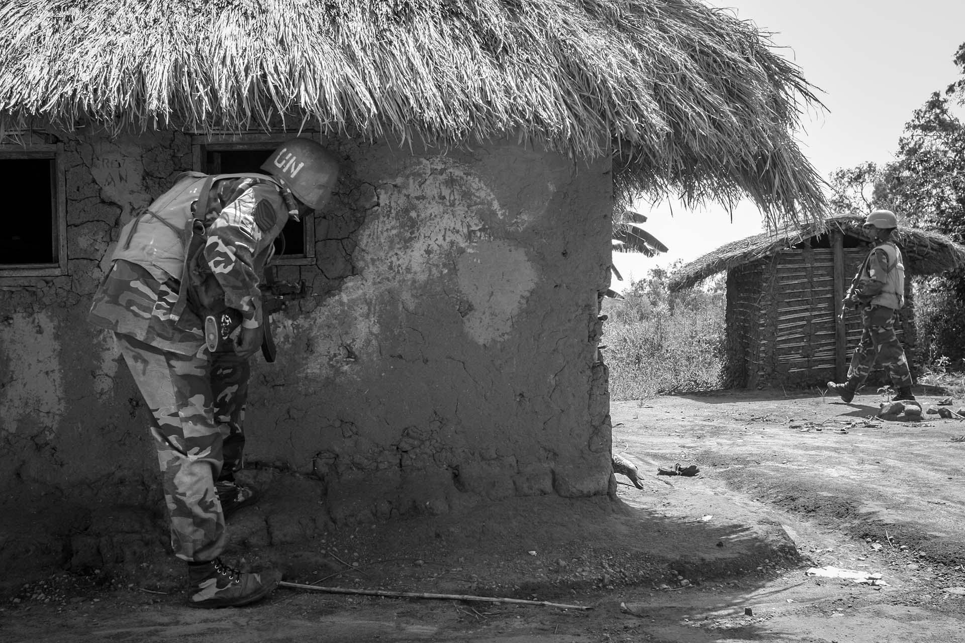 A UN peacekeeper from Bangladesh conduct a foot patrol in the village of Kaswara where there was fighting between militia and government soldiers supported by UN.