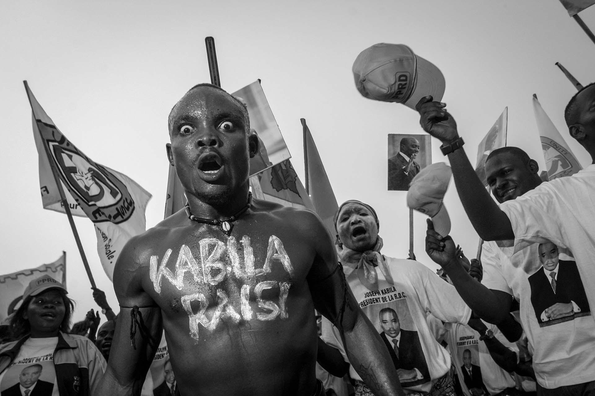 Supporters of Joseph Kabila in a frenzy at a rally in Kinshasa.