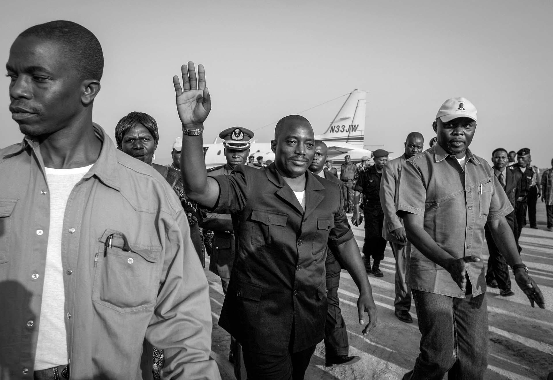 Joseph Kabila greets his supporters at Bunia airport July 12, 2006. The war-torn country had not had a national for election more than 40 years ago. Kabila retained his presidency, again in 2011. He attempted but failed to amend constitution so he can run for a 3rd term.