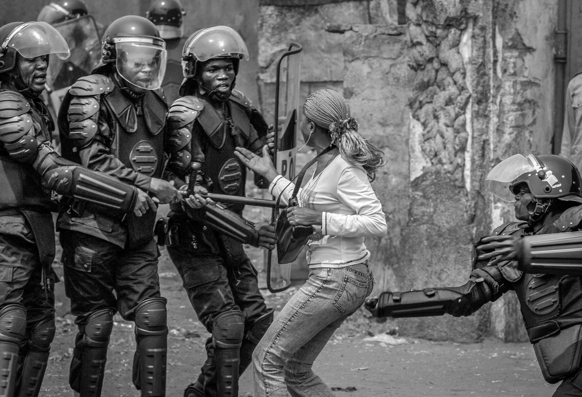 Congolese riot police arrest a UDPS supporter on the nation's independence day.