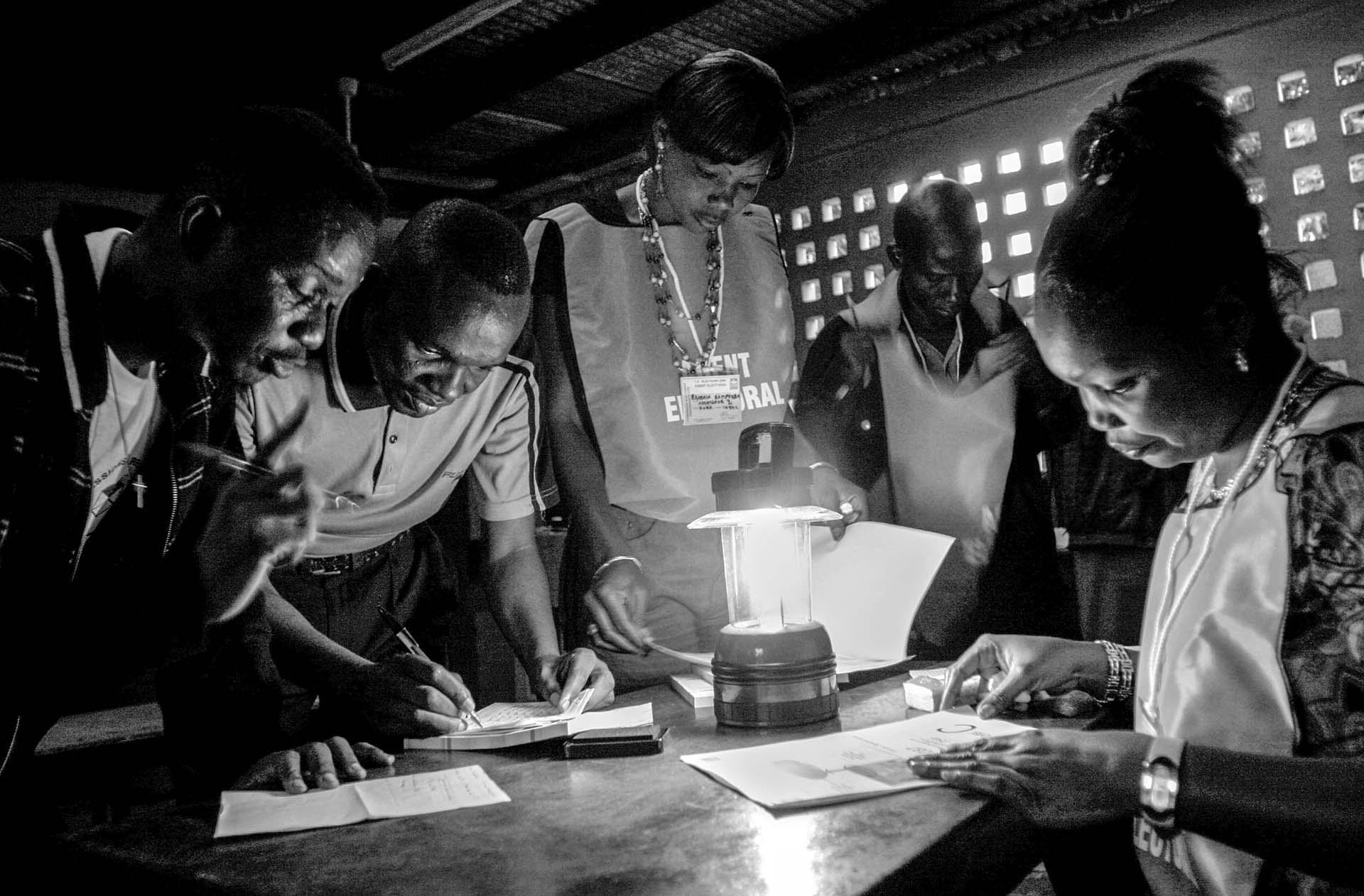 Election workers work on the last minute details before they open the ballot boxes in the early morning in Kinshasa, the capital of Democratic Republic of Congo for the 2nd round of the presidential election.