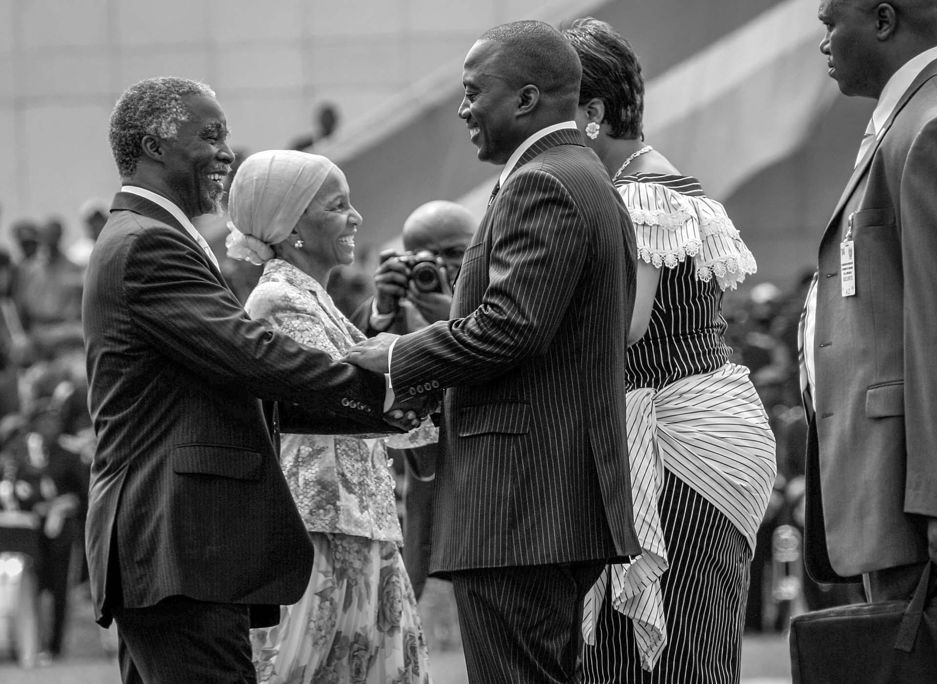 Joseph Kabila, a newly elected president of the Democratic Republic of Congo, is congratulated by Thabo Mbeki, South African president, during the inauguration ceremony in the capital Kinshasa.