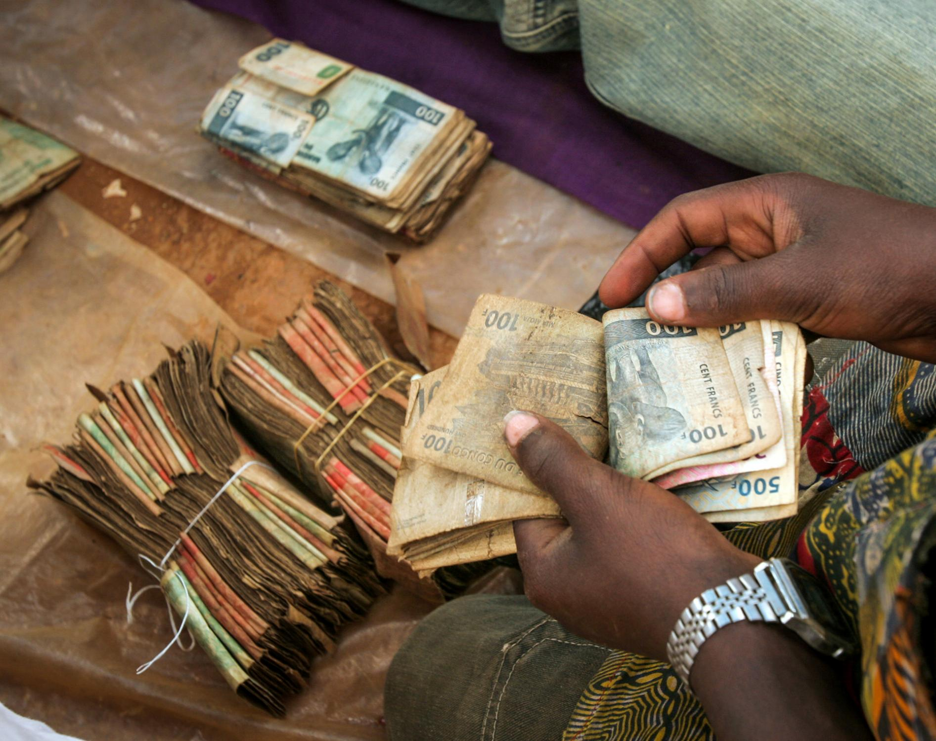 Money changing hands at a busy gold market in Iga-Barriere in Ituri. Most of the gold is smuggled to Uganda and Rwanda then onto the world market.