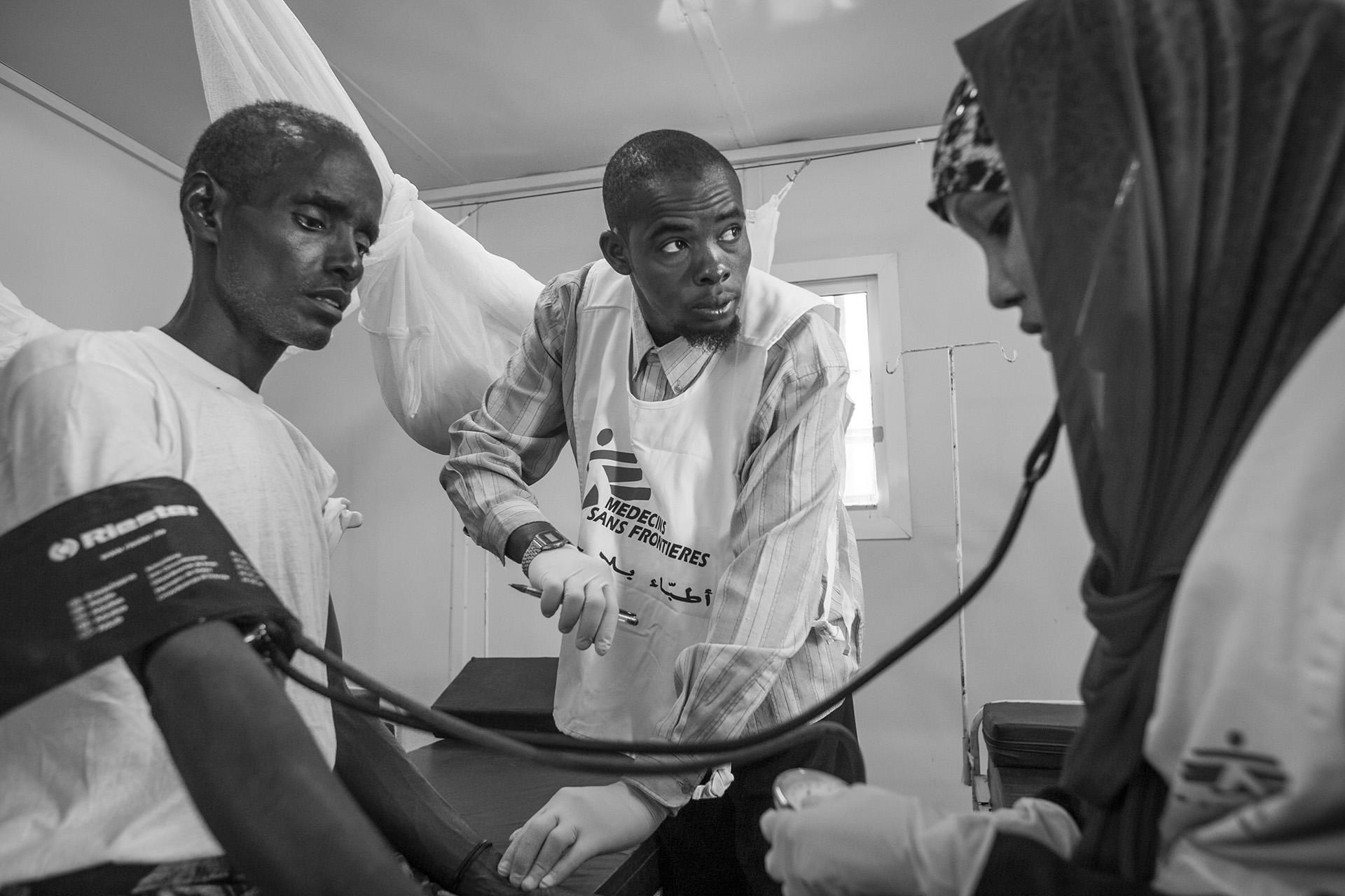 A refugee being treated by MSF (Doctors Without Borders) staff at a reception center in Ahwar on the Yemeni coast. The new arrivals received first aid, food and water on the shore and then transferred to the reception center for a complete medical examination by MSF and assistance from various other organizations.