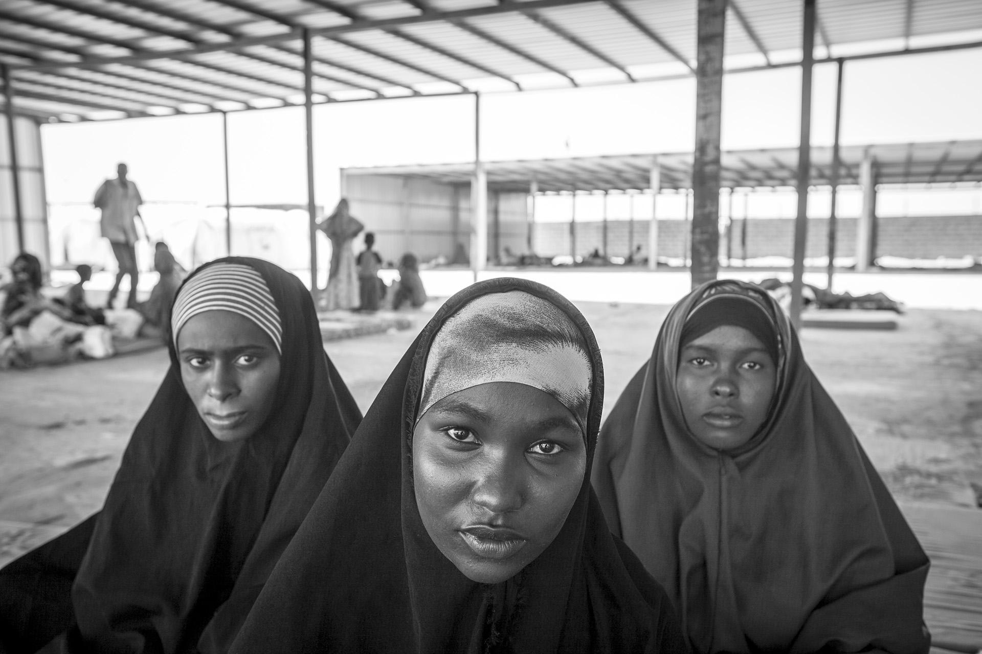 Refugees recuperate at a reception center in Ahwar the day after their arrival at the Yemeni coast from Somalia. Two sisters and a cousin traveled together from Mogadishu to Bosasso, Somaliland, then to Yemen. After being ejected into the open water in total darkness of a moonless night, they called to each other to stay alive. After recovery, they will either try to find work in Yemen, the poorest nation in Middle East in the middle of the civil war in the world's worst humanitarian crisis, or get smuggled into other countries such as Saudi Arabia.