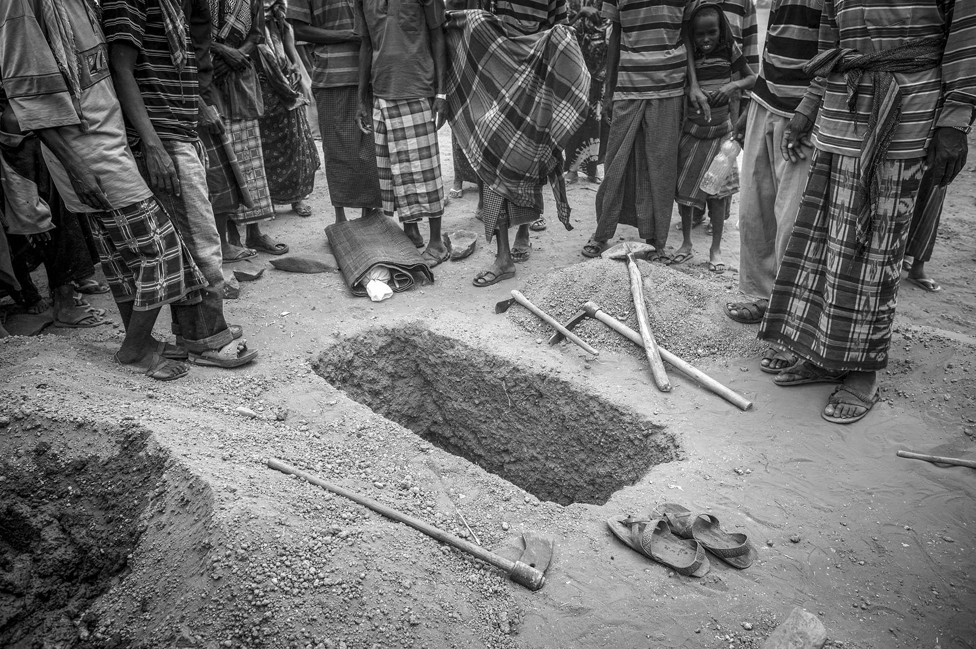 1 1/2-year-old Sahro Mohammed is being buried in Kobe Refugee Camp in southeastern Ethiopia, a few kilometers from Somalia/Ethiopia border, August 12, 2011.
