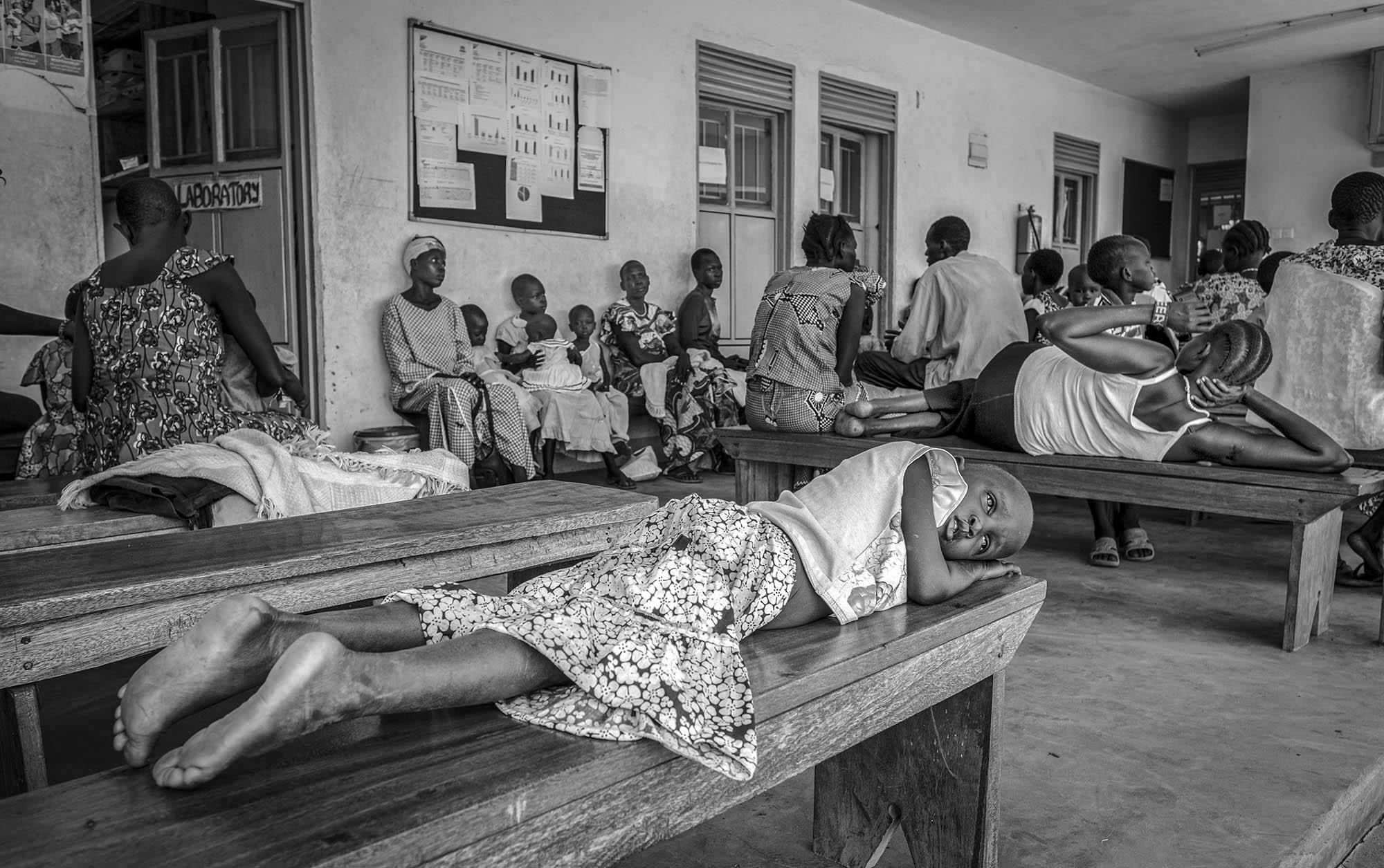 South Sudanese refugees wait for service at a health center in Nyumanzi refugee settlement in Adjumani District of Northern Uganda on May 3, 2017.