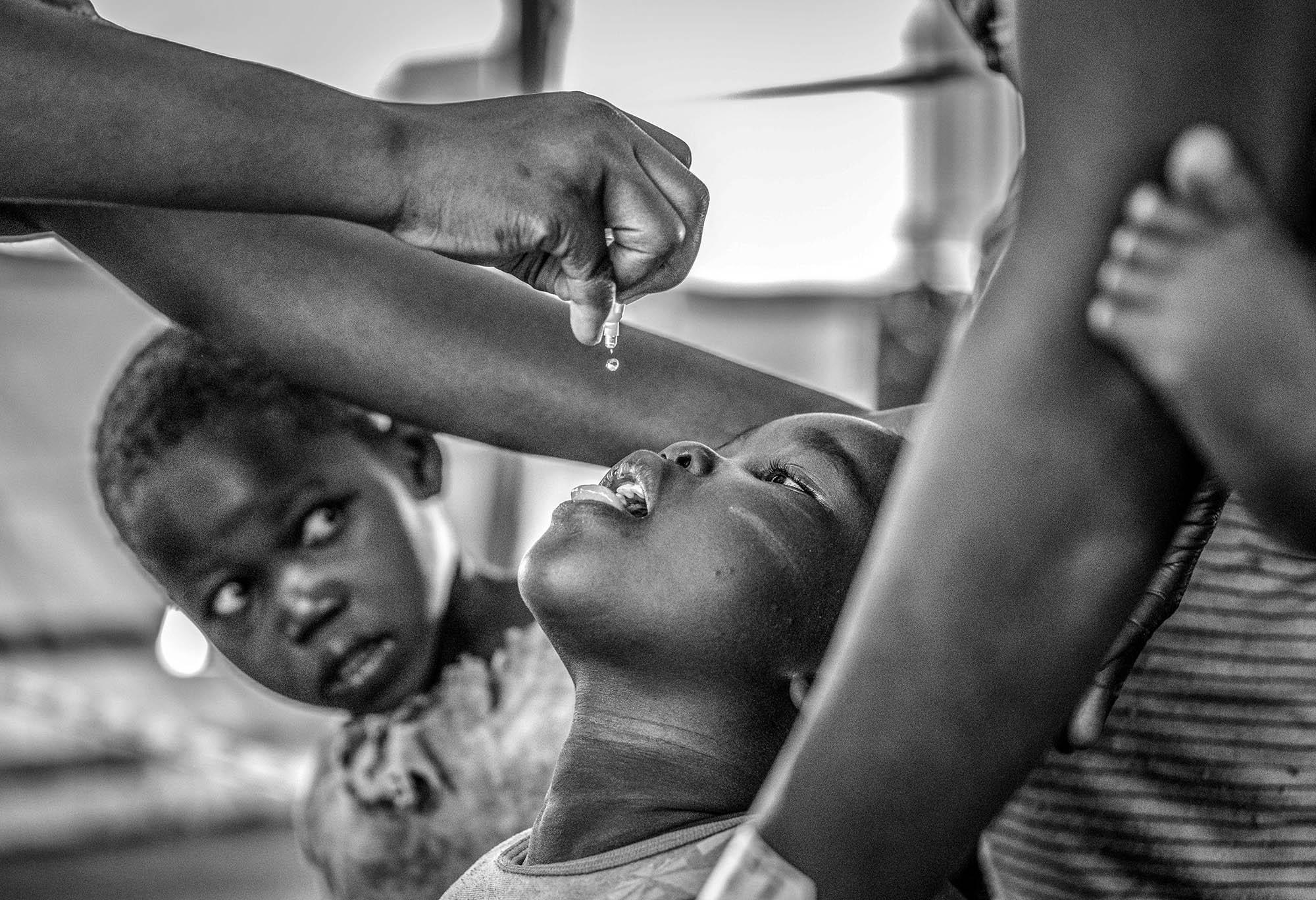 A child receives a polio vaccine upon arrival at Imvepi reception center in Arua district in Northern Uganda near the border with South Sudan on May 1, 2017.