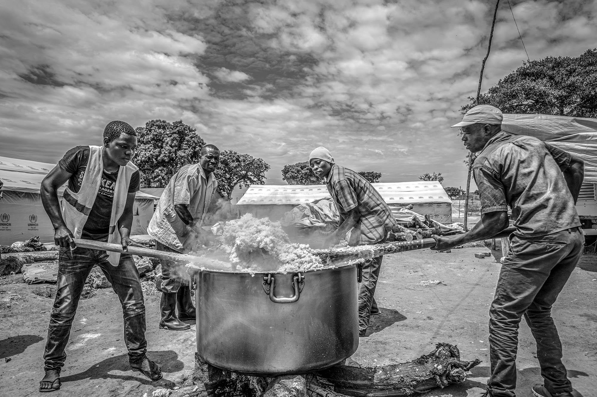 A hot corn meal is being prepared for new arrivals at Kuluba collection point in Koboko district in Northern Uganda near South Sudan on May 1, 2017