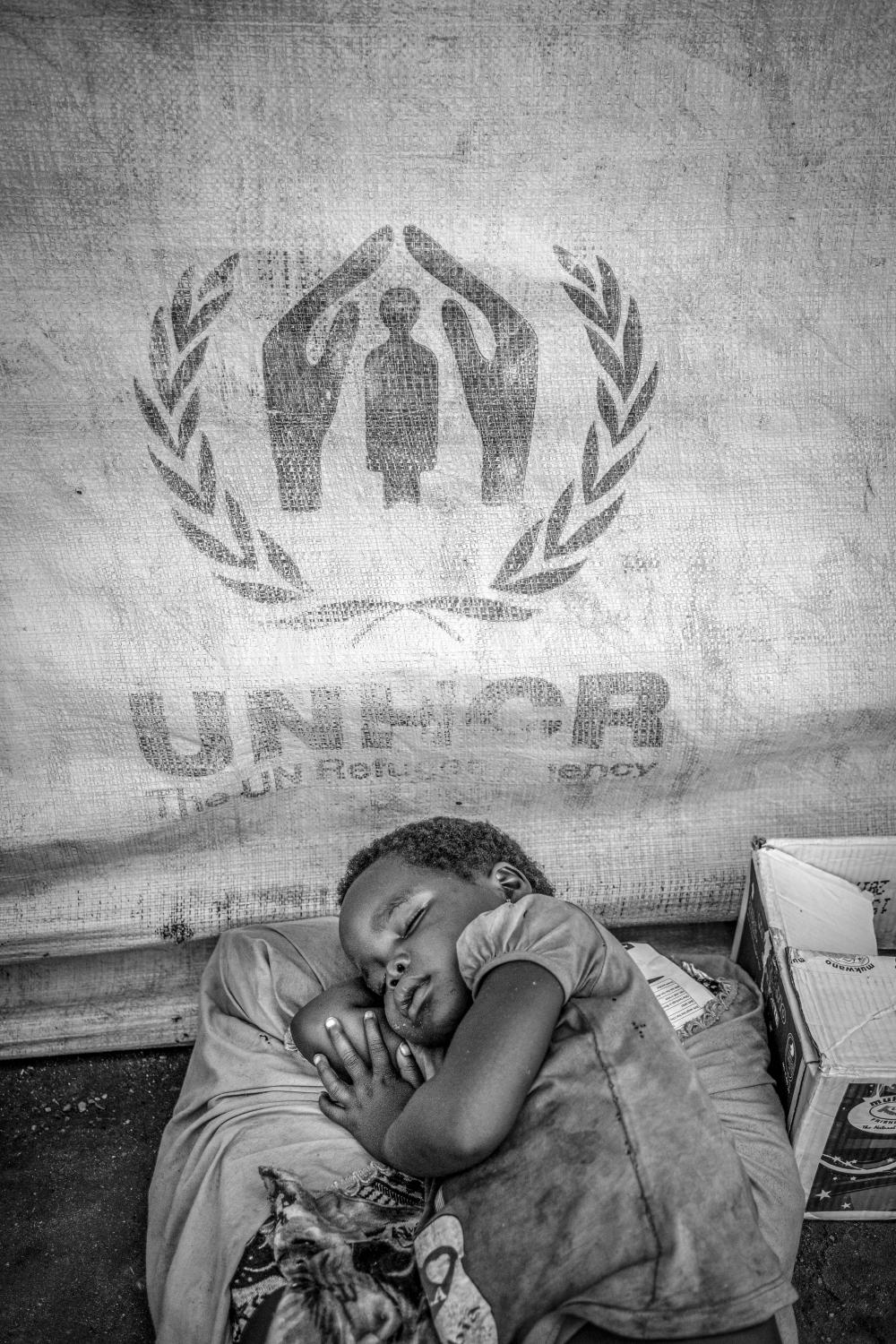 Exhausted from a long and treacherous journey from South Sudan, a young girl sleeps soundly at Kuluba collection point in Koboko district in Northern Uganda, near the border with South Sudan on May 1, 2017.