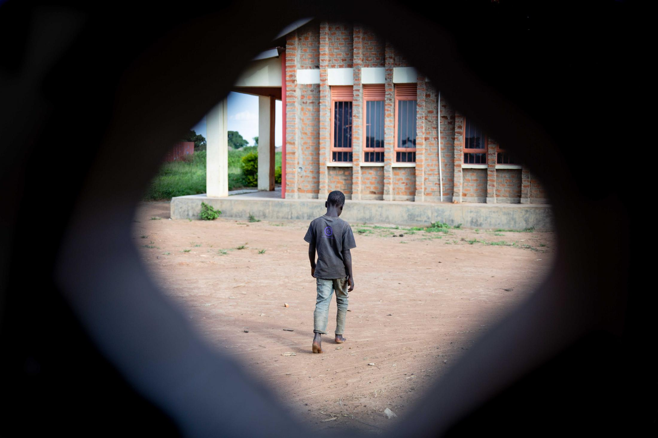 A child walks at the now deserted rehabilitation center, Hope for Humans that used to house and take care of some of the sick children suffering from nodding syndrome in Omoro and neighbouring districts.