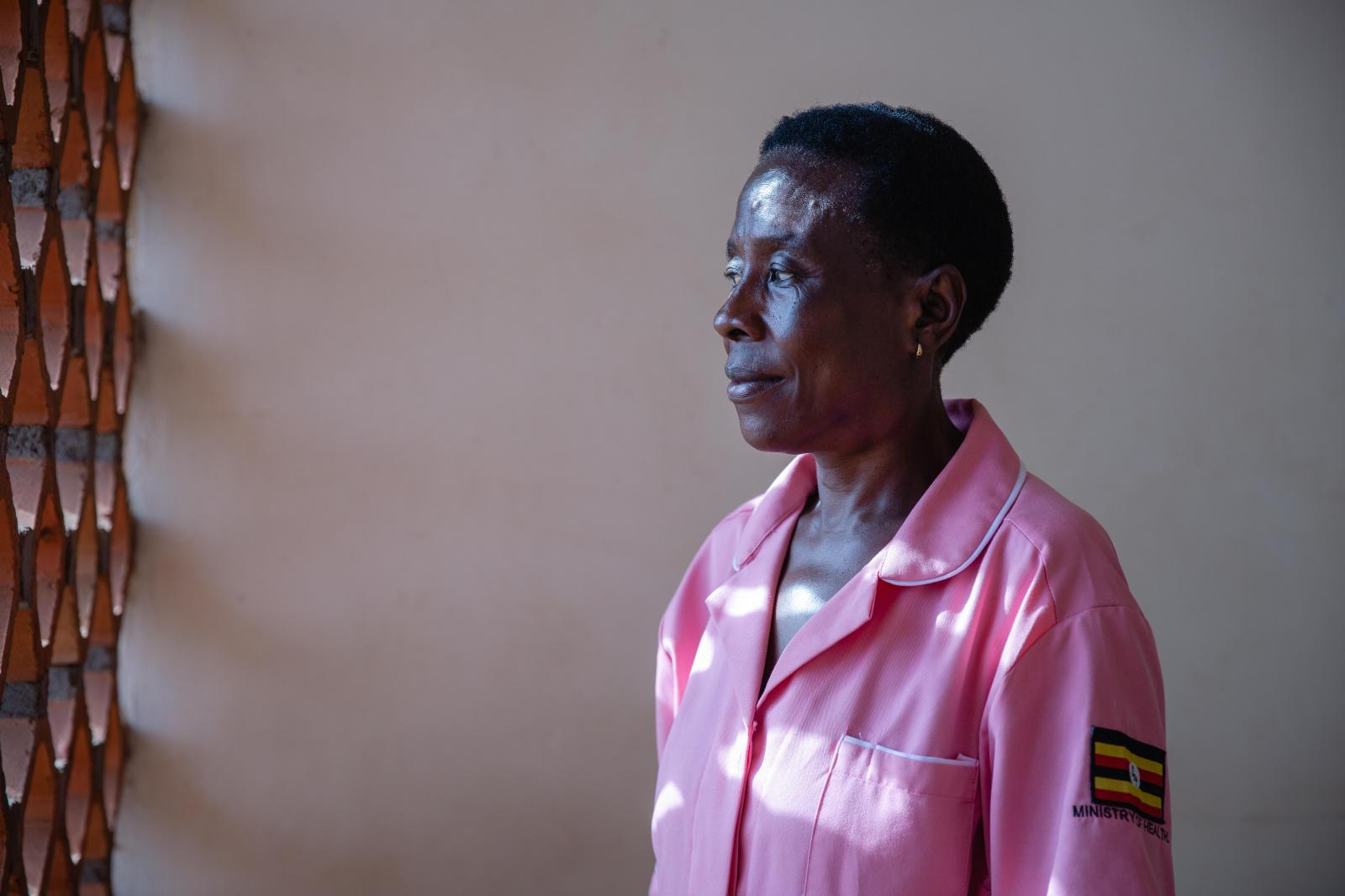 A portrait of Nurse Margaret Kasolo, 57, at Kawala Health Center IV in Kampala, Uganda. She has been a midwife for 35 years and has worked with Action Aid since 2013 as a Gender Based Violence focal person at the hospital. Margaret links clients that need help from Action Aid to the organisation's shelters and Action Aid links clients that need medical attention to her at the hospital. For Action Aid UK.