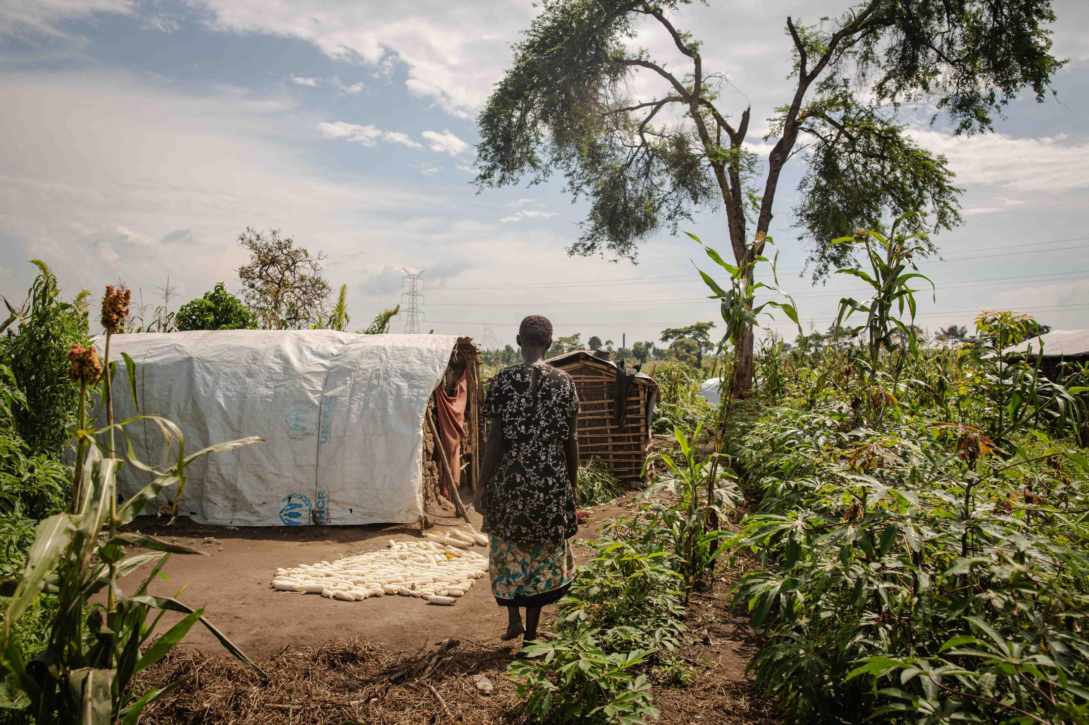 Oriem Jannette, 61, at her home in Kilima village, Kyangwali Refugee Settlement. Jannette lost her husband and three of her children during the 2000 war in DRC. She now lives in the settlement with her two grandchildren. For Norwegian Refugee Council.