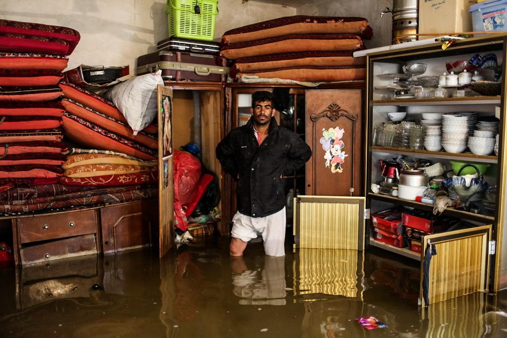 Portrait of 30-year-old Mohammed in his grandfather's house in ein 2 Area. 5 families live in this house and flood has destroyed their lives Ahvaz